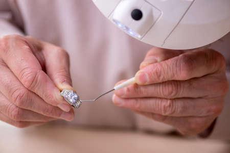 Old jeweler at the workshop