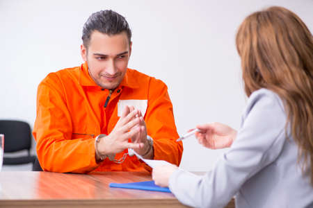 Young man meeting with advocate in pre-trial detention