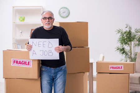 Old male professional mover doing home relocation