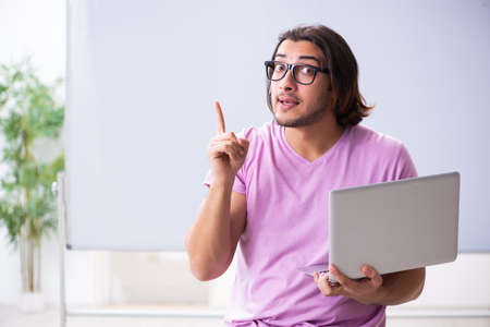 Young male student in telestudying concept