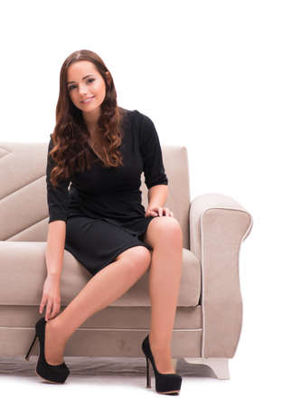 Woman trying new shoes sitting on sofa Stock Photo