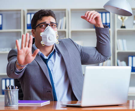 Businessman sweating excessively smelling bad in office at workplace Banque d'images