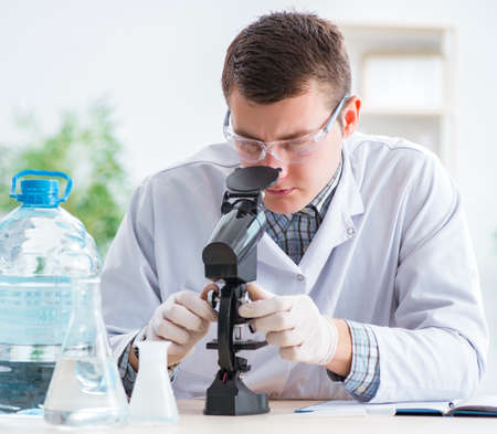 The young chemist student experimenting in lab
