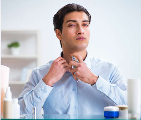 Man is getting dressed up for work in bathroom Stock Photo