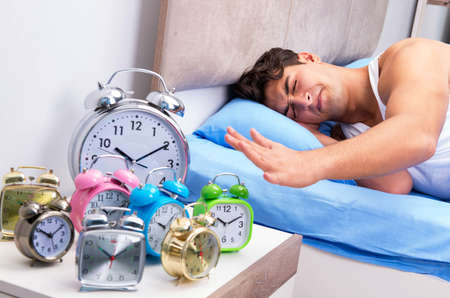 Man having trouble waking up in morning