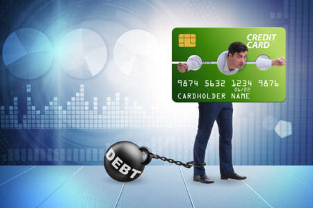 Businessman in credit card burden concept in pillory 版權商用圖片