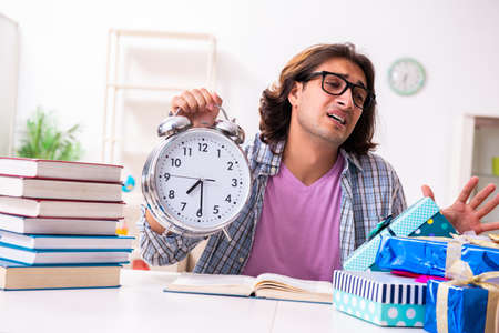 Young male student preparing for exams Stock Photo
