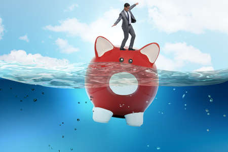 The businessman in debt concept with piggybank