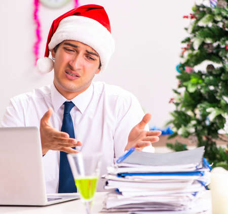 Employee businessman celebrating christmas in office