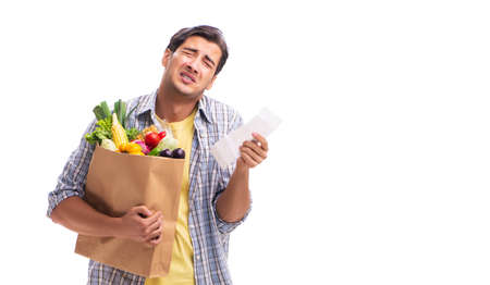 Young man with his grocery shopping on white