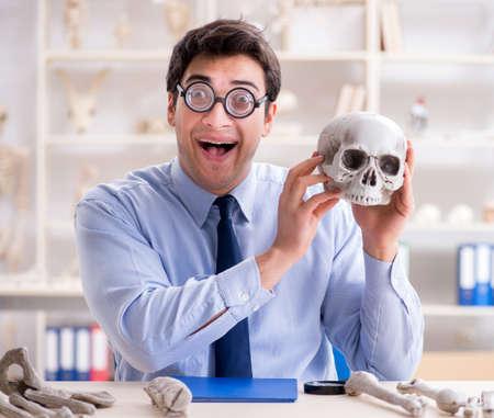 Funny crazy professor studying human skeleton Archivio Fotografico