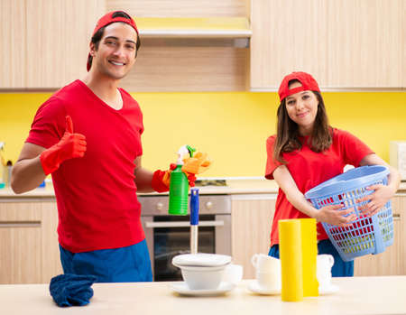 Cleaning professional contractors working at kitchen