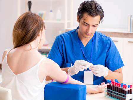 Young patient during blood test sampling procedure