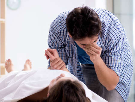 Man mourning his dead wife