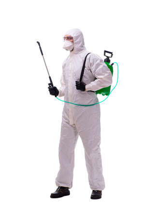 Young male contractor disinfecting in coronavirus concept