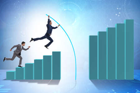 The businessman vault jumping over bar charts Stockfoto