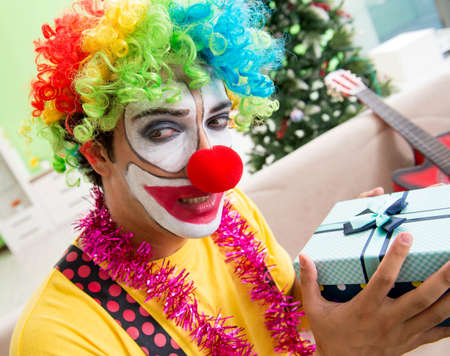 The funny clown in christmas celebration concept
