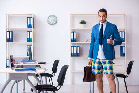 Young male employee in travel preparation concept