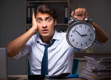 Young financial manager working late at night in office