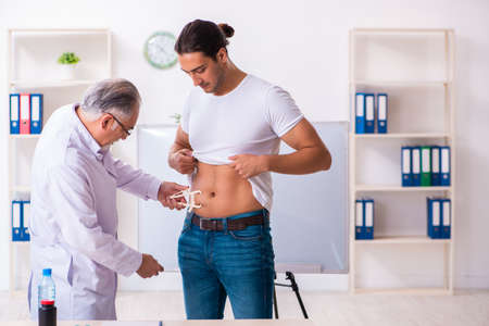 Doctor dietician giving advices to fat overweight patient Zdjęcie Seryjne