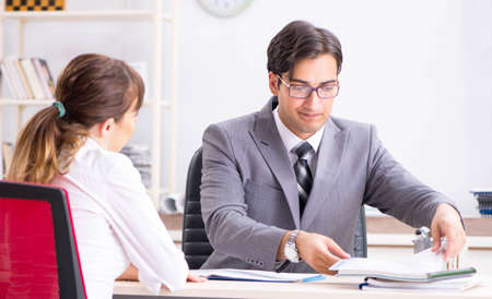 Man and woman discussing in office