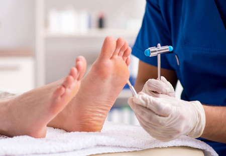 The podiatrist treating feet during procedure