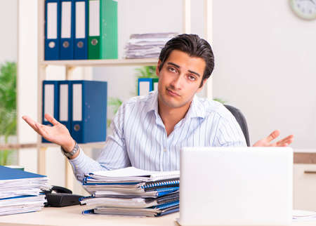 Young employee sitting at the office Stock Photo