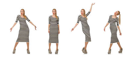 The young woman in long striped dress isolated on white
