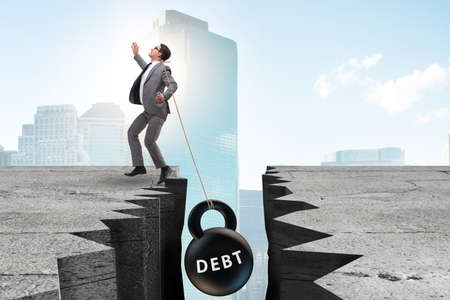 Concept of debt and load with businessman