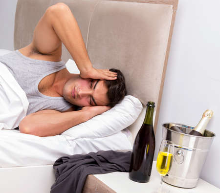 Man having hangover after night party Stock Photo