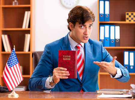 Young handsome politician sitting in office Stock fotó - 146126948