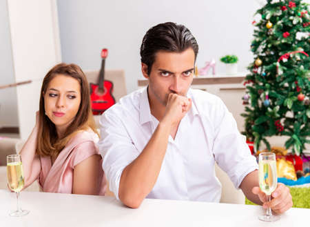 Young pair conflicting at christmas night