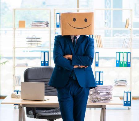 Happy man with box instead of his head Foto de archivo