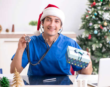 Doctor with gift box in the hospital