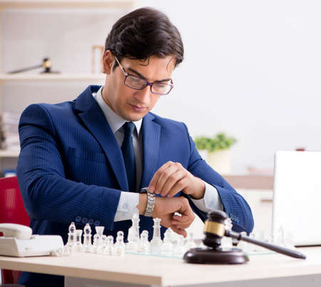 Young lawyer playing chess to train his court strategy and tacti