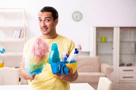 Young male contractor doing housework at home