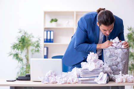 Businessman rejecting new ideas with lots of papers Imagens
