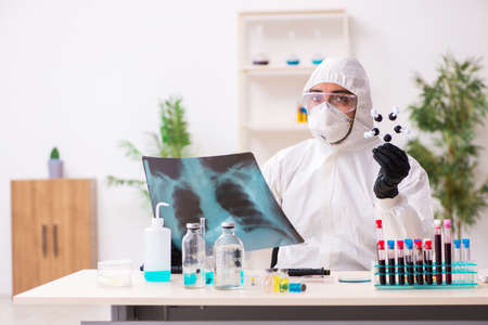 Doctor working in lab in coronavirus COVID-19 concept