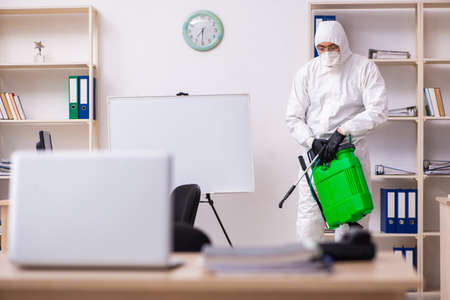 Contractor disinfecting office for COVID-19 coronavirus