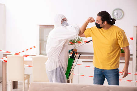 Sanitizer and young man indoors in disinfection concept Foto de archivo