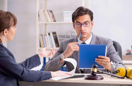 Lawyer talking to client in office