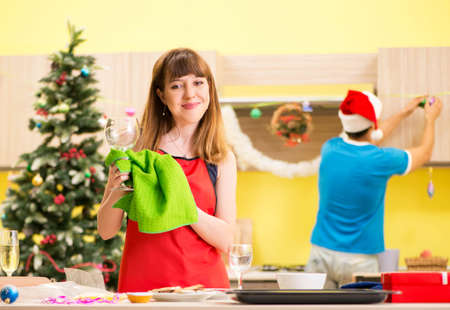 Young couple celebrating Christmas in kitchen