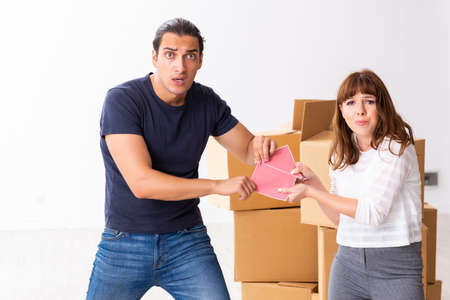 Young pair and many boxes in divorce settlement concept Stock Photo