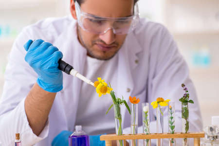 Young male chemist in perfume synthesis concept