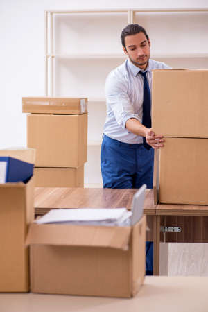 Young male employee in relocation concept
