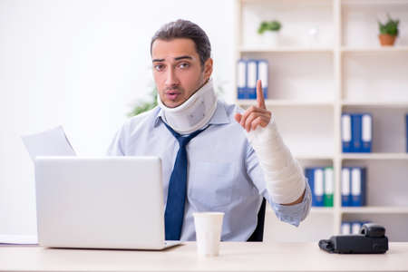 Injured male employee at workplace after accident