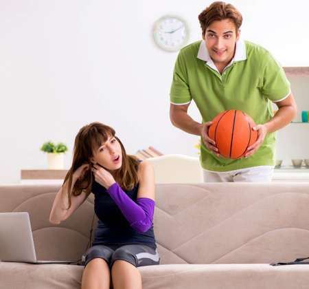 Man and woman discussing sports injury