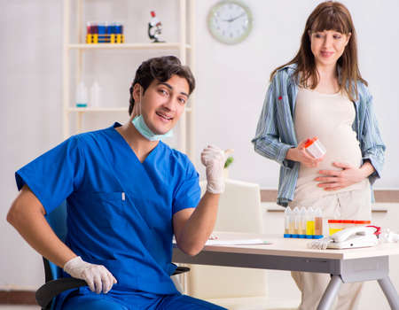 Pregnant woman visiting doctor for check-up Stok Fotoğraf