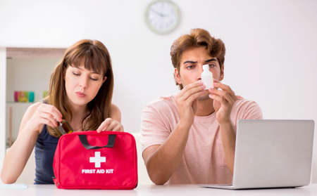Young family getting treatment with first aid kit Stok Fotoğraf