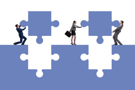 Businessman in teamwork concept with jigsaw puzzle